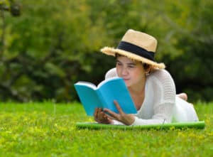 Woman woman engrossed in book